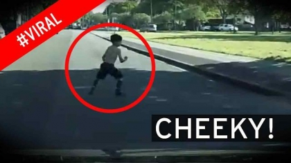 Cheeky young boy interrupts driving lesson when he TWERKS in road